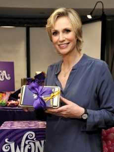 Jane Lynch smiles with her new sweet treats from Wonka Exceptional Chocolates!