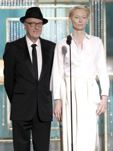 Geoffrey Rush and Tilda Swinton speak onstage during the Golden Globes at the Beverly Hilton International Ballroom in Beverly Hills on January 16, 2011 