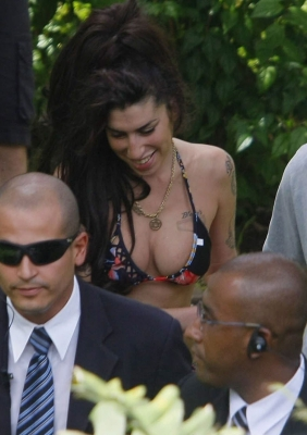 Amy Winehouse is all smiles at the swimming pool of Santa Teresa Hotel in Rio de Janeiro, Brazil on January 12, 2011
