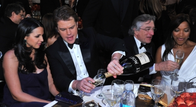 Matt Damon and wife Luciana, along with Robert De Niro, enjoy the scene inside the 2011 Golden Globes