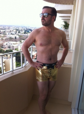 Ricky Gervais on the balcony of his hotel rocking a pair of golden &#8220;Ellen&#8221; underwear on January 17, 2011