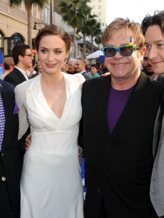 David Furnish, Emily Blunt, Sir Elton John and Actor James McAvoy arrive at the Premiere Of Touchstone Pictures' 'Gnomeo And Juliet' held at the El Capitan Theatre on January 23, 2011 in Hollywood, California.