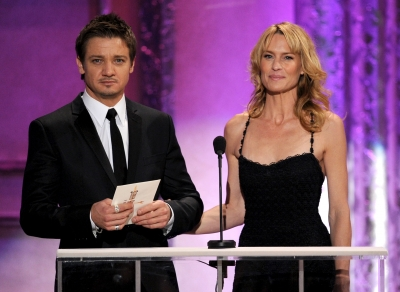 Jeremy Renner and Robin Wright present the nominees for Outstanding Male Actor in a TV Movie or Miniseries during the 17th Annual Screen Actors Guild Awards on January 30, 2011