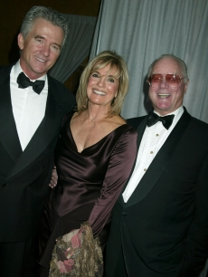 "Patrick Duffy, Linda Gray and Larry Hagman of ""Dallas"" at a cocktail party celebrating CBS's 75th anniversary, Nov. 2, 2003"