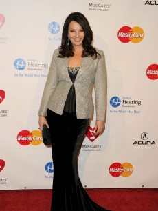 Fran Drescher arrives at the 2011 MusiCares Person of the Year Tribute to Barbra Streisand held at the Los Angeles Convention Center on February 11, 2011