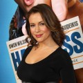 Alyssa Milano show off her new baby bump at the premiere of &#8220;Hall Pass&#8221; in Los Angeles on February 23, 2011 