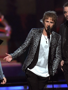 Matthew Bellamy, Christopher Wolstenholme and Dominic Howard of Muse accept an award onstage during The 53rd Annual Grammy Awards held at the Staples Center in Los Angeles, Calif., on February 13, 2011