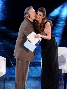 Elisabetta Canalis gets a kiss from Robert De Niro at the 61st Sanremo Song Festival at the Ariston Theatre in San Remo, Italy, on February 18, 2011