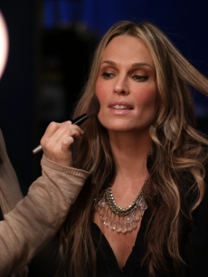 Molly Sims gets a quick touch-up backstage before her appearance on Access Hollywood Live on February 22, 2011
