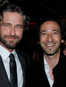 Gerard Butler and Adrien Brody spend time together at Harvey Weinstein and Dior's Oscar Dinner at Chateau Marmont  in Los Angeles, Calif., on February 23, 2011