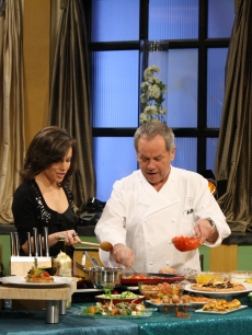 Chef Wolfgang Puck stops by to show Billy Bush and Kit Hoover what he's got cooking for the post-Oscars Governor's Ball menu on Access Hollywood Live on February 25, 2011