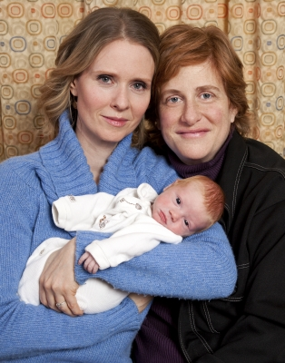 Cynthia Nixon and Christine Marinoni pose with their son Max on February 11, 2011 in New York City