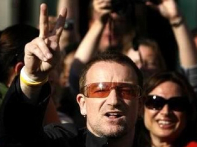 Bono, U2 frontman and universal good doer shows the sign of peace