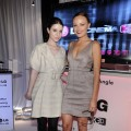 Michelle Trachtenberg and Malin Akerman smile while checking out the LG Cinema 3D HDTV