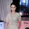 Michelle Trachtenberg poses in the LG Cinema 3D HDTV lounge backstage at the 2011 Film Independent Spirit Awards at Santa Monica Beach in Santa Monica, Calif. on February 26, 2011