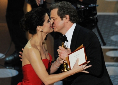 "Colin Firth accepts the award for Best Performance by an Actor in a Leading Role for ""The King's Speech"" from presenter Sandra Bullock onstage during the 83rd Annual Academy Awards held at the Kodak Theatre, Hollywood, Calif., on February 27, 2011"