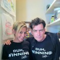 "Charlie Sheen and his ""goddess"" Natalie Kenly wearing Charlie's new T-shirts, ""Duh, Winning"""