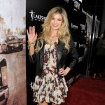 "Marisa Miller waves to the crowd at the premiere of ""The Lincoln Lawyer"" held in the Cinerama Dome at Arclight Hollywood in Hollywood, Calif., on March 10, 2011"