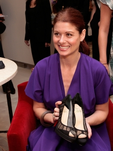 Debra Messing as she purchases the first pair of shoes on SAKS Fifth Ave's Designer Shoe floor during the Unveiling of SAKS Fifth Ave's '10022-SHOE', its new designer shoe floor that, due to its size was given its own 'ZIP Code' at the SAKS Fifth Avenue Store on August 17, 2007 in New York City