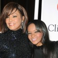 Whitney Houston and Bobbi Kristina Brown arrives at the 2011 Pre-Grammy Gala and Salute To Industry Icons Honoring David Geffen at Beverly Hilton in Beverly Hills, Calif. on February 12, 2011 