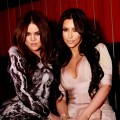 Khloe Kardashian and Kim Kardashian pose at JET Nightclub in Las Vegas on March 18, 2011