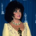 Elizabeth Taylor poses with her Oscar at the 65th Annual Academy Awards at the Shrine Auditorium in Los Angeles on March 29, 1993