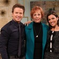 Carol Burnett poses with Access Hollywood Live hosts Billy Bush and Kit Hoover on March 24, 2011