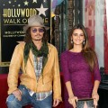 Johnny Depp and Penelope Cruz pose for photographers during the installation ceremony for her star on the Hollywood Walk of Fame in Hollywood, Calif. on April 1, 2011