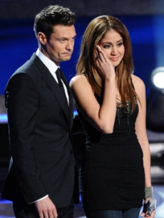Karen Rodriguez and Ryan Seacrest on the &#8220;American Idol&#8221; stage on March 17, 2011