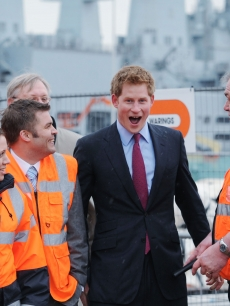 An animated Prince Harry meets workers at the site of the new Mary Rose Museum during a visit to the Mary Rose Museum in Portsmouth, United Kingdom on March 18, 2011 
