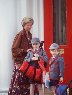Prince William is all geared up for school in this photo taken outside the Wetherby School with his mother, Princess Diana, and his brother, Prince Harry, in April 1990 