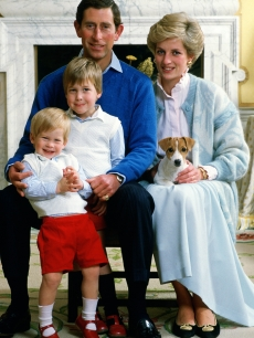 Prince William poses in an early family photograh with his father, Prince Charles, mother, Princess Diana, and brother, Prince Harry, at home in Kensington Palace in December 1986