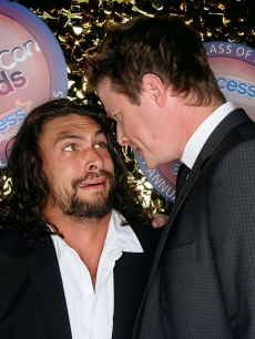 "Billy Bush stares down ""Conan the Barbarian"" hunk Jason Momoa at CinemaCon 2011 in Las Vegas, Nevada on March 31, 2011"