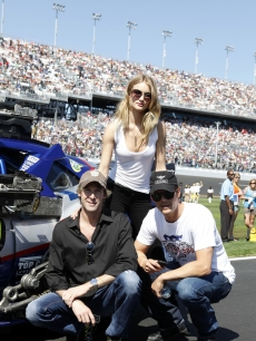 "Director Michael Bay poses with ""Transformers: Dark of the Moon"" stars Josh Duhamel and Rosie Huntington-Whiteley pose before the Daytona 500 at Daytona International Speedway in Daytona Beach, Florida, on February 20, 2011"