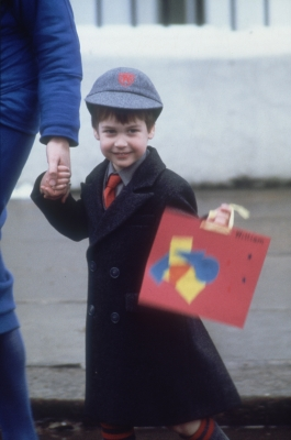 Prince William is all smiles on his first day of school in London on January 15, 1987