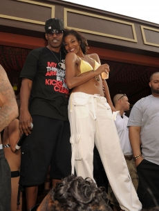Jamie Foxx and Gabrielle Union smile at the fifth season opening of TAO Beach in Las Vegas on April 2, 2011 