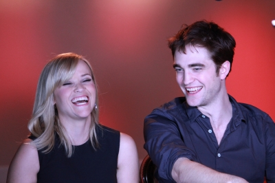 "Reese Witherspoon laughs as she and Robert Pattinson share tales of making ""Water for Elephants,"" Santa Monica, April 3, 2011"