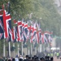 Police walk along the Mall ahead of the Royal Wedding of Prince William to Catherine Middleton at Westminster Abbey, London, on April 29, 2011