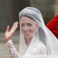 Catherine Middleton waves as she arrives for the Royal Wedding of Prince William to Catherine Middleton at Westminster Abbey in London on April 29, 2011 