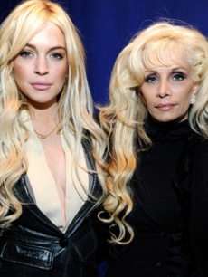 Lindsay Lohan and Victoria Gotti pose together the &#8220;Gotti&#8221; press conference at Sheraton New York Hotel &amp; Towers, Central Park West Room in New York City on April 12, 2011