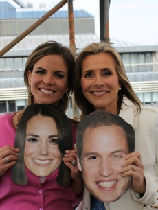 Natalie Morales and Meredith Vieira have a little fun before appearing on Access Hollywood Live, outside Westminster Abbey, London, April 26, 2011