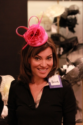 Pretty in pink! Access Hollywood Live's Kit Hoover tries on another beautiful hat at Harrods in London, April 26, 2011