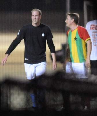 Prince William smiles while playing soccer in a South London park on April 26, 2011