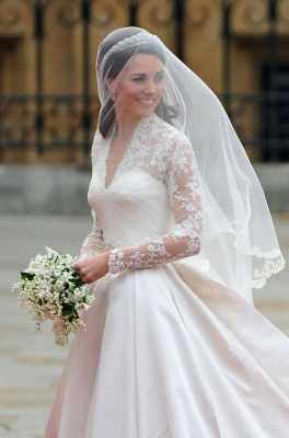 Catherine Middleton waves to the crowds before walking in to the Abbey to attend the Royal Wedding of Prince William to Catherine Middleton at Westminster Abbey in London on April 29, 2011
