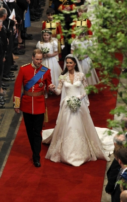 Prince William, Duke of Cambridge and Catherine, Duchess of Cambridge smile following their marriage at Westminster Abbey in London, England on April 29, 2011