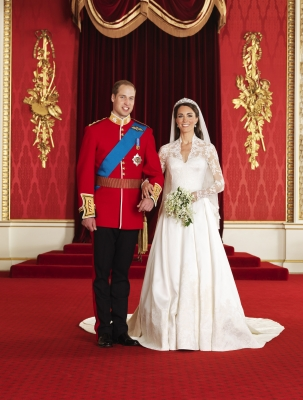 Prince William, Duke of Cambridge and Catherine, Duchess of Cambridge pose for an official photo in the throne room at Buckingham Palace in London, England, on April 29, 2011
