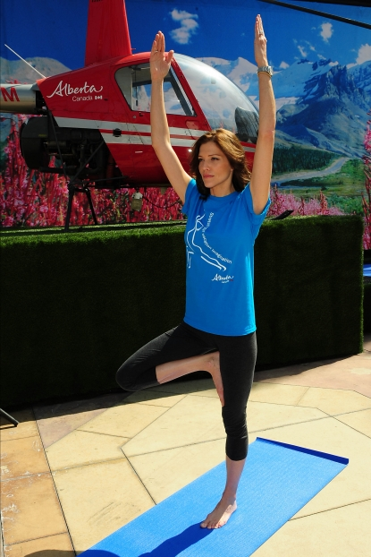Tricia Helfer participates in virtual heli-yoga at Irvine Spectrum Center as part of Travel Alberta's kick-off to the summer travel season, Tuesday, April 12, 2011