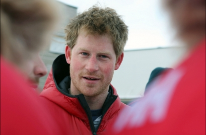 Britain's Prince Harry smiles before departing for the airport to load their kit before the flight to the Borneo ice field on April 2, 2011