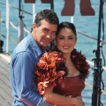 Antonio Banderas and Salma Hayek get cozy at the &#8220;Puss in Boots&#8221; photocall at Carlton Beach during the 64th Cannes Film Festival in Cannes, France on May 11, 2011 