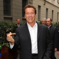 Arnold Schwarzenegger smokes a cigar in Milan, Italy on November 18, 2009